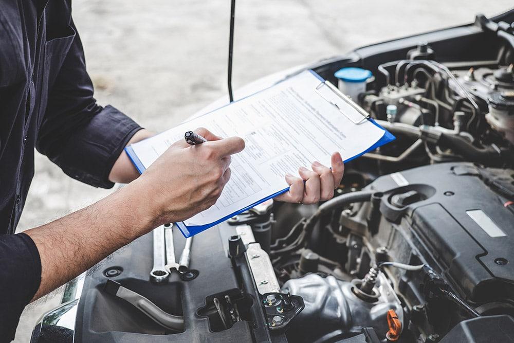 A mechanic doing paperwork   Range Rover Evoque Falkirk, Stirling, Alloa