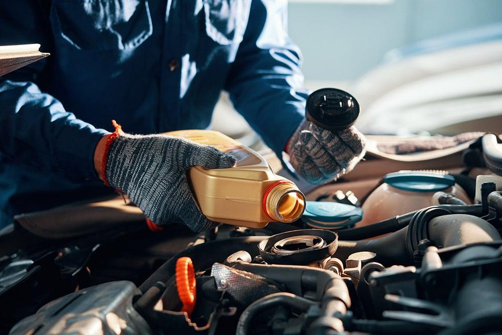 Mechanic pouring oil | Range Rover Sport specialist Falkirk, Stirling, Alloa