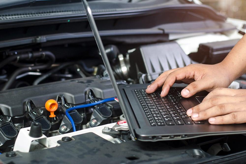 Image of laptop next to vehicle   Range Rover Velar service Alloa, Stirling, Falkirk